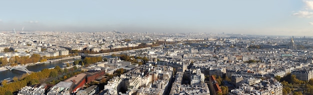 Cityscape of paris city. aerial panoramic view of paris roofs and seine river as seen from eiffel tower in autumn time