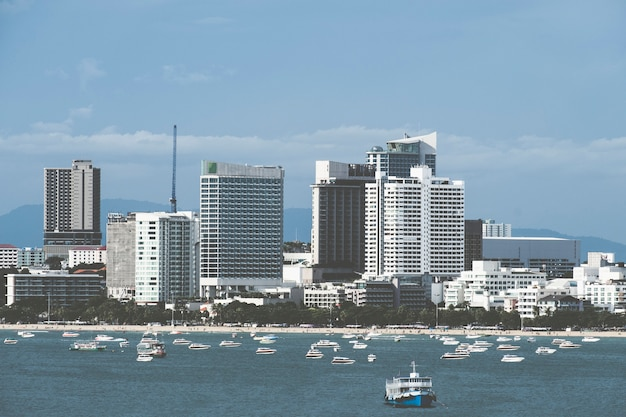 Cityscape of pattaya in thailand and speed boat.