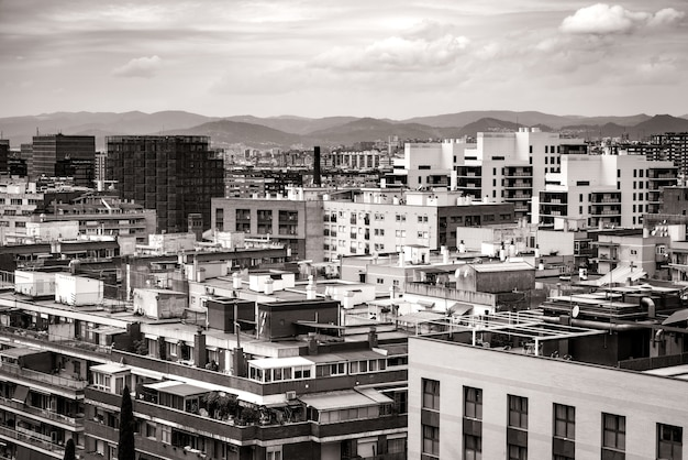 Cityscape of the roofs of several residential buildings of barcelona in black and white
