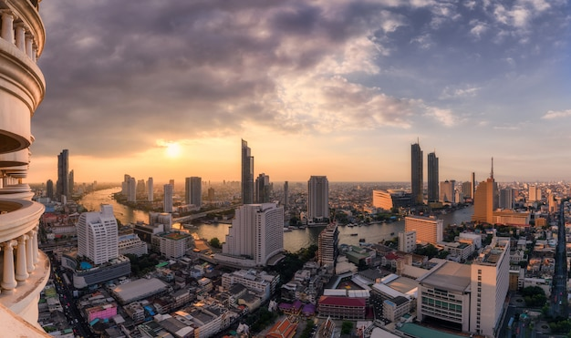 Cityscape of skyscraper with chao phraya river at sunset in bangkok