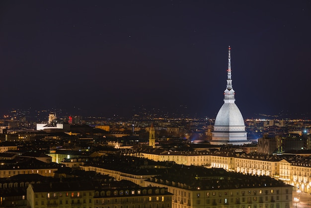 Cityscape of torino (turin, italy) by night with starry sky