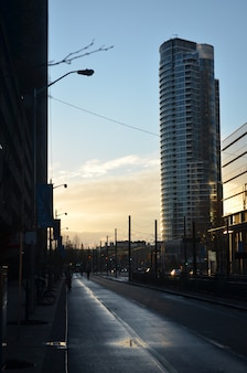 Cityscape of toronto city with the sun going down behind the buildings