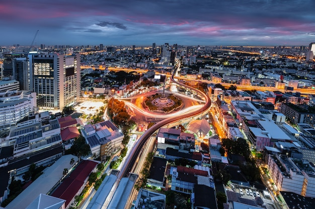 Cityscape of victory monument with car traffic on the roundabout road in the morning at bangkok