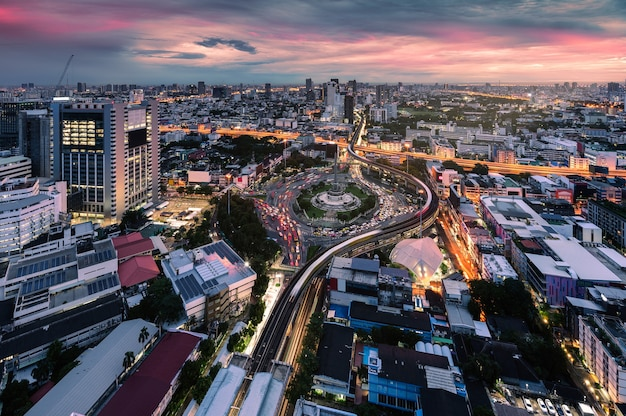 Cityscape of victory monument with car traffic on roundabout road in the morning at bangkok