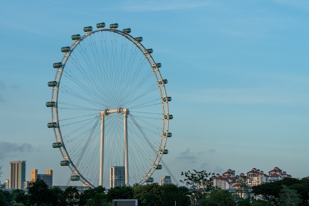 Cityscape view of singapore and the singapore flyer against a blue sky