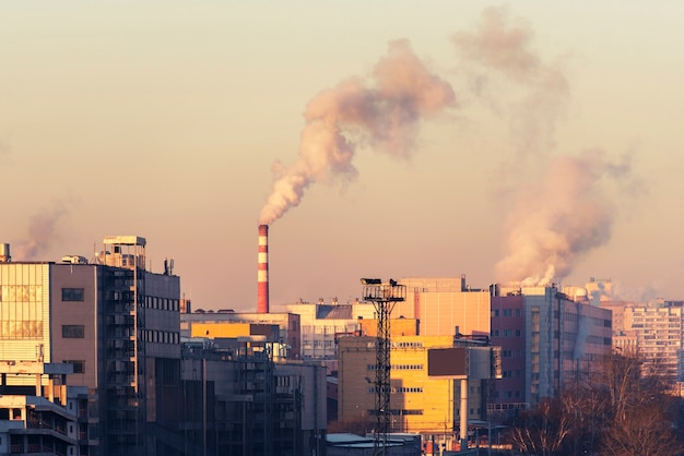 Cityscape with factories, pipes that pollute the air. moscow, russia