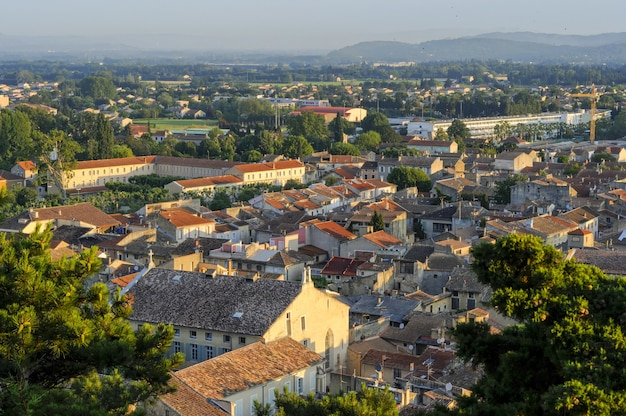 A cityscape with a lot of buildings in france in the summer dawn at the park colline saint europe