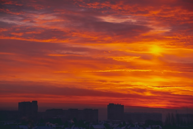 Cityscape with vivid fiery dawn