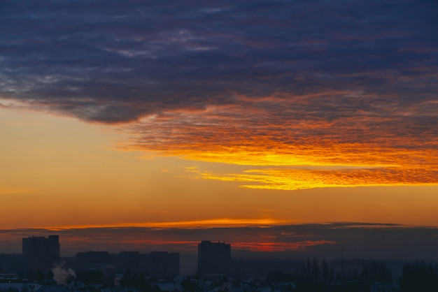 Cityscape with wonderful varicolored fiery dawn.