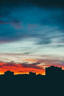 Cityscape with wonderful varicolored vivid dawn. amazing dramatic multicolored cloudy sky