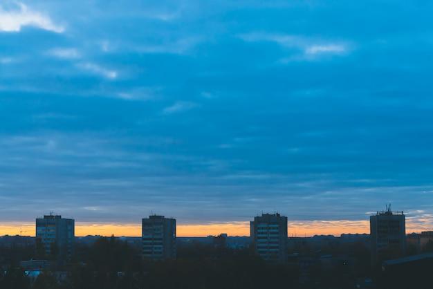 Cityscape with wonderful varicolored vivid dawn.