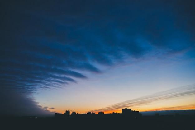 Cityscape with wonderful varicolored vivid dawn