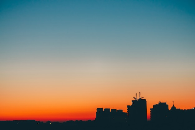 Cityscape with wonderful varicolored vivid dawn.