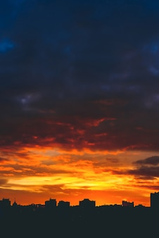Cityscape with wonderful varicolored vivid fiery dawn