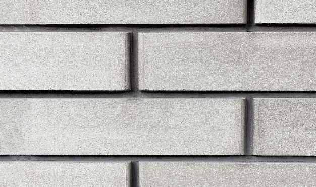 클래딩 벽돌 질감 클로즈업입니다. 건물의 벽과 기초의 외부 장식, 건설 개념.