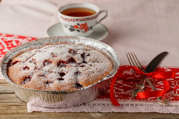 Clafoutis cherry pie on rustic wooden table