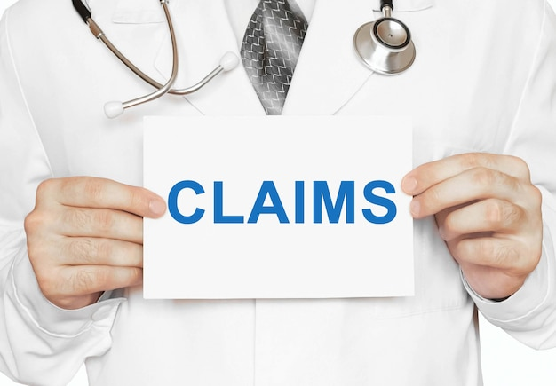 Claims card in hands of medical doctor