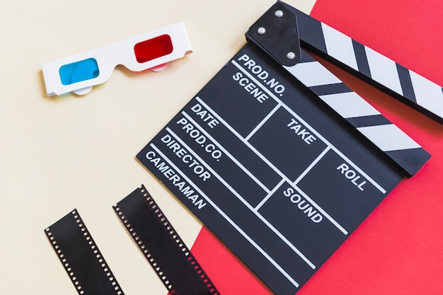 Clapboard near 3d glasses