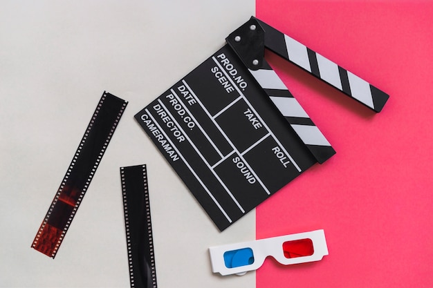 Clapboard near carton 3d glasses