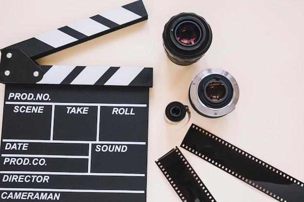Clapperboard, camera lenses and film reels