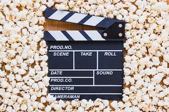 Clapperboard lying in popcorn