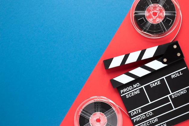 Clapperboard and movie reels with copy space