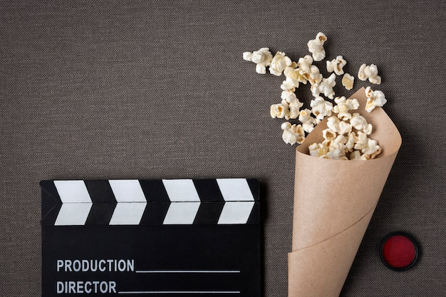 Clapperboard and package with popcorn