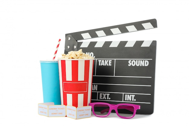 Clapperboard, paper cup, bucket with popcorn, tickets and glasses isolated on white