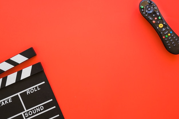 Clapperboard, remote control and space