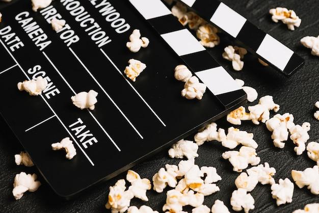 Clapperboard on spilled popcorn