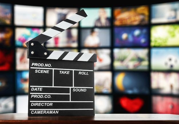Clapperboard on the of television screens