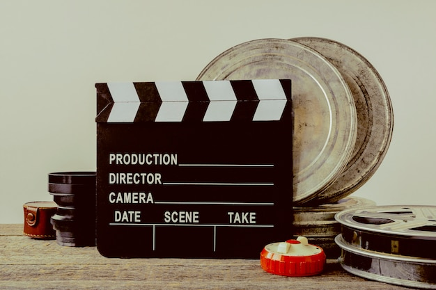 Clapperboard, tin boxes with film and lens