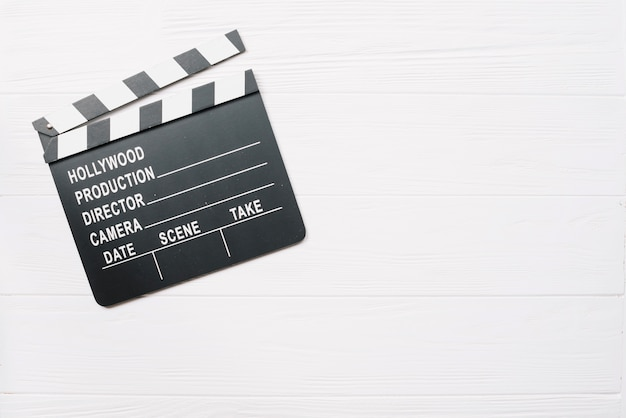 Clapperboard on white wooden table