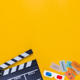 Clapperboard with cinema tickets and 3d glasses