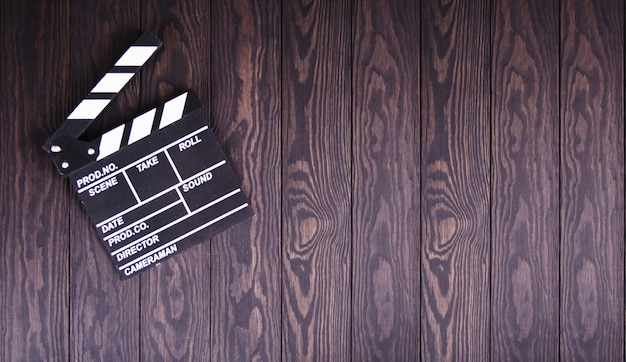 Clapperboard on wood concept the film industry, movie, film, golden globe and oscar as the substrate
