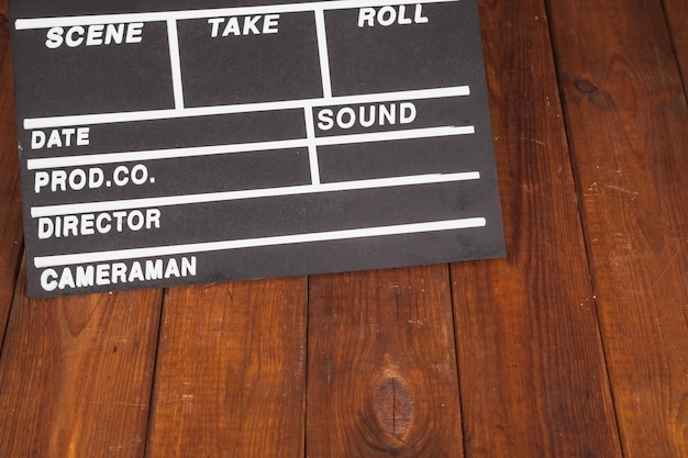 Clapperboard on wooden tabletop