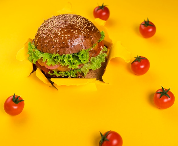 Classic beef burger with cherry tomatoes