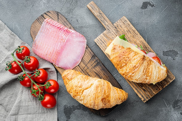 Classic blt croissant sandwiches set, on gray stone background, top view flat lay
