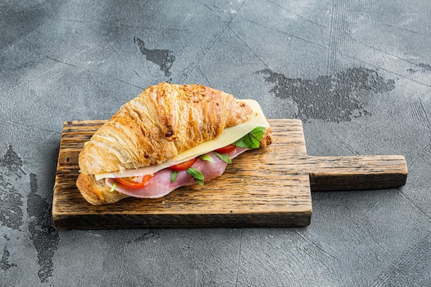 Classic blt croissant sandwiches set, on gray stone background