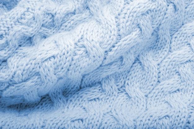 クラシックなブルーのニット生地のウールの質感の背景。ブルーの暖かいセーターテキスタイル素材
