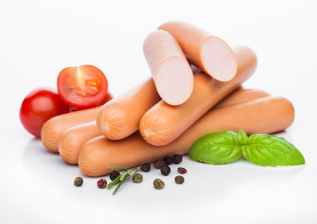 Classic boiled meat pork sausages with pepper and basil