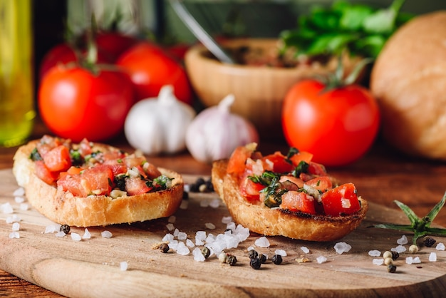 Classic bruschettas with tomatoes and ingredients