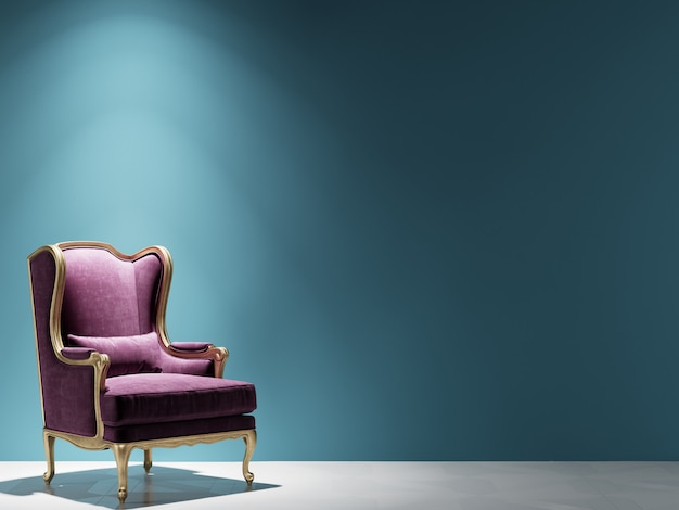 Classic burgundy velvet armchair standing in front of blue wall