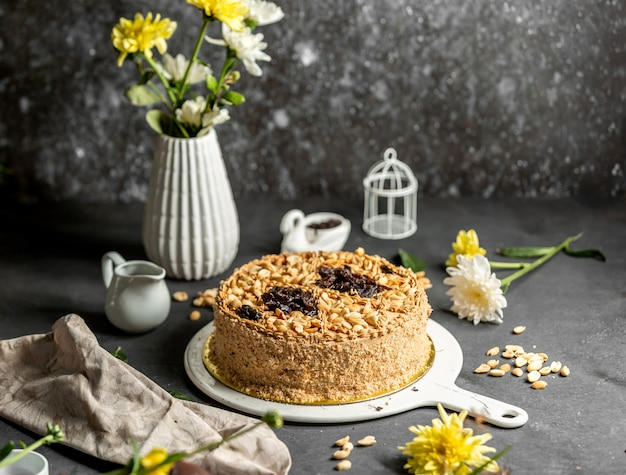Classic cake topped with peanuts and raisins