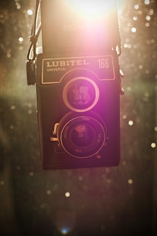 Classic camera with sun background