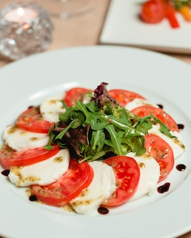 Classic caprese salad with mozzarella cheese and tomatoes