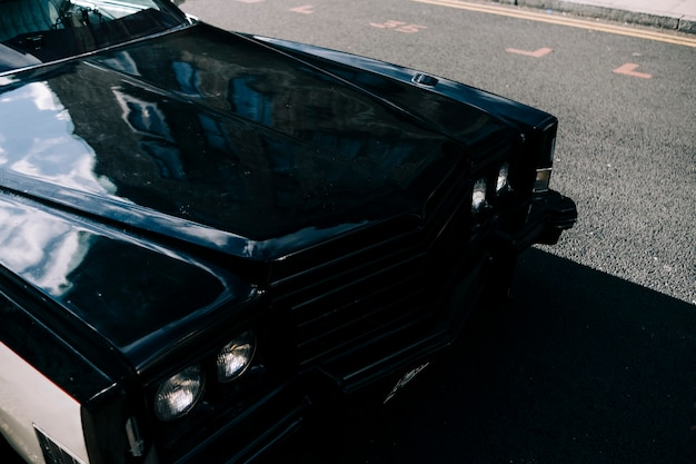 Classic car background reflection on bonnet and chrome of retro. vehicle old automotive restoration and auto detailing