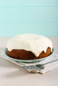 Classic carrot cake with frosting served on plate