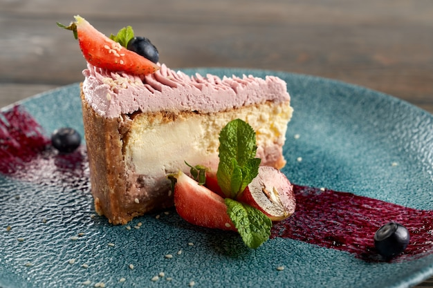 Classic cheesecake with berries on decorated plate