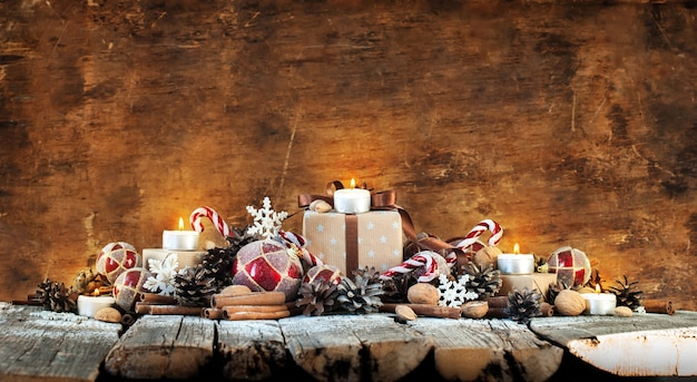 Classic christmas composition with candles on wooden background